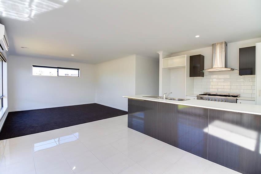 Modern adu above garage with kitchen