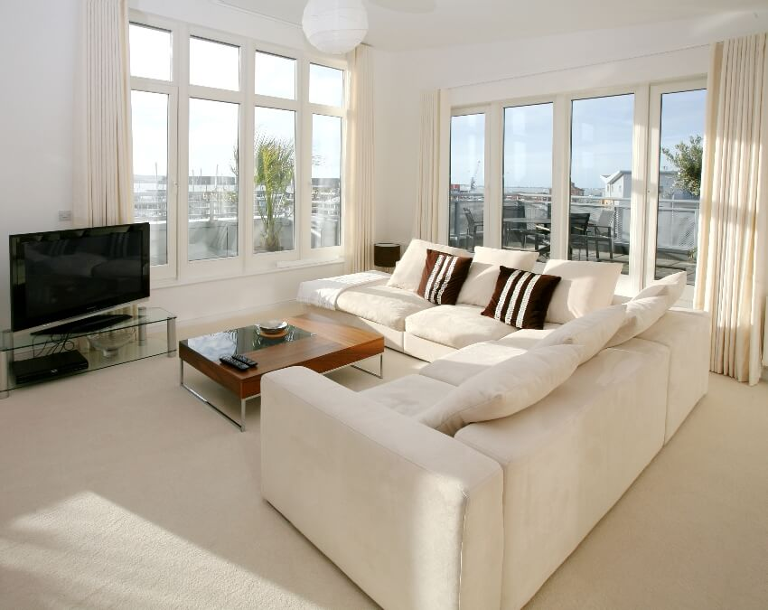 Modern apartment living room with corner suite and flat screen tv