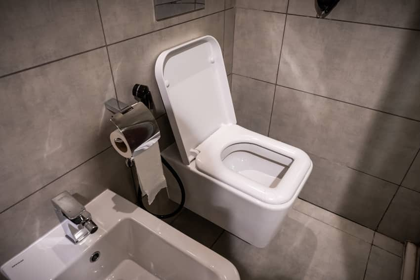 Modern bathroom interior with square-shaped toilet seat
