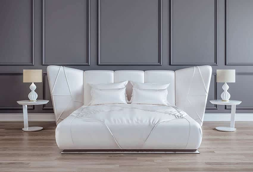 Modern bed with white satin sheets