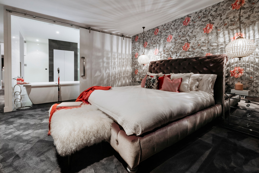 Modern bedroom interior with cozy bed and eye catching walls