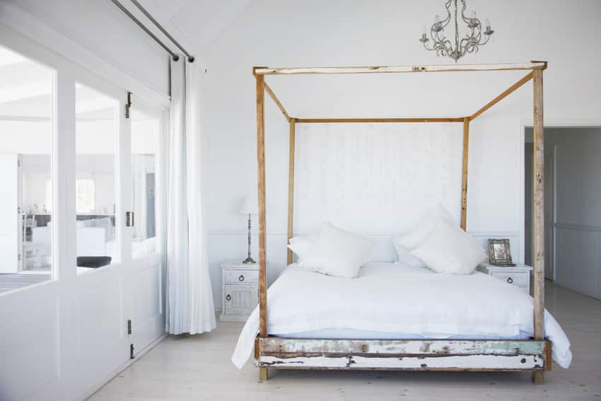 Modern bedroom interior with stylish four poster bed