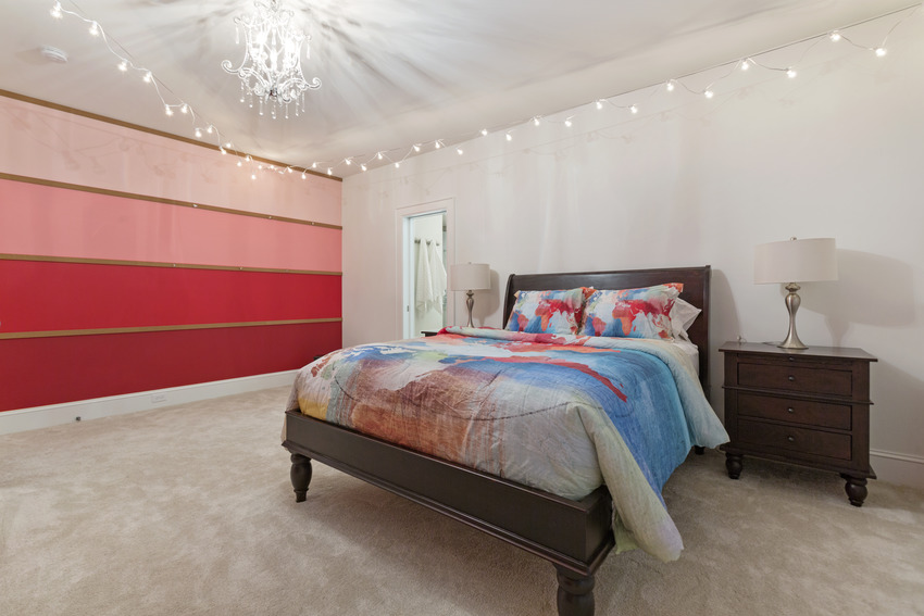 Modern bedroom with eye catching walls light fixtures and cozy bed