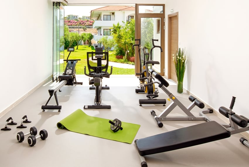 modern concept of green nature eco style home gym with open air garden