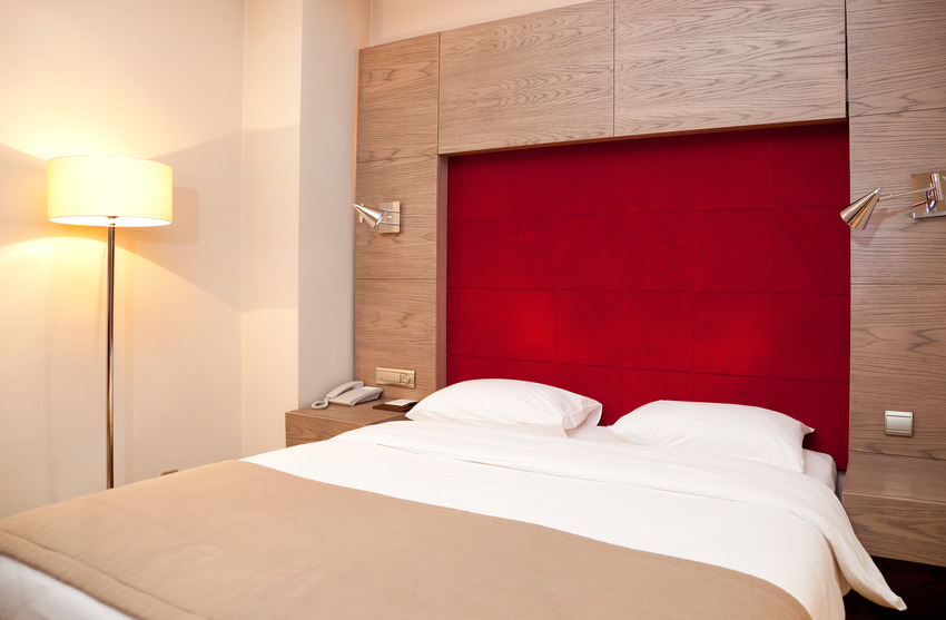 Modern cozy bedroom with red accent wall