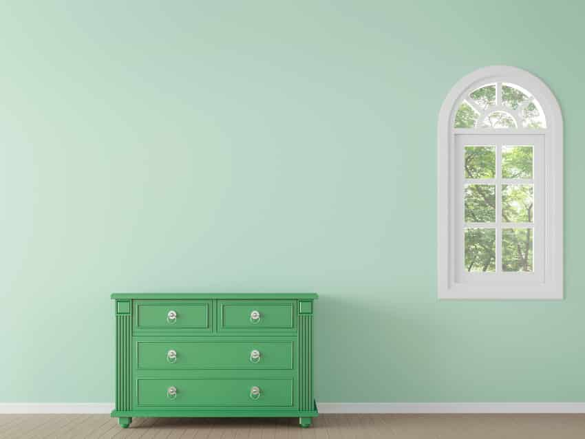 Modern empty green room with dresser painted with milk paint