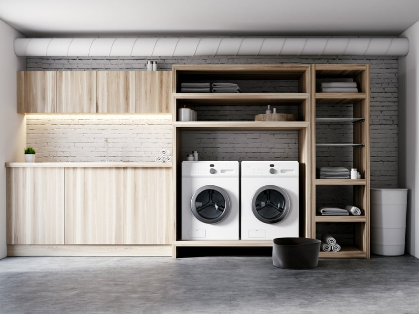 modern garage laundry room interior with white brick walls wooden consoles and shelves with two white washing machines