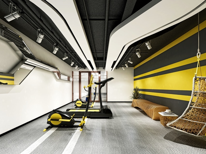 modern home gym interior with yellow black and white walls