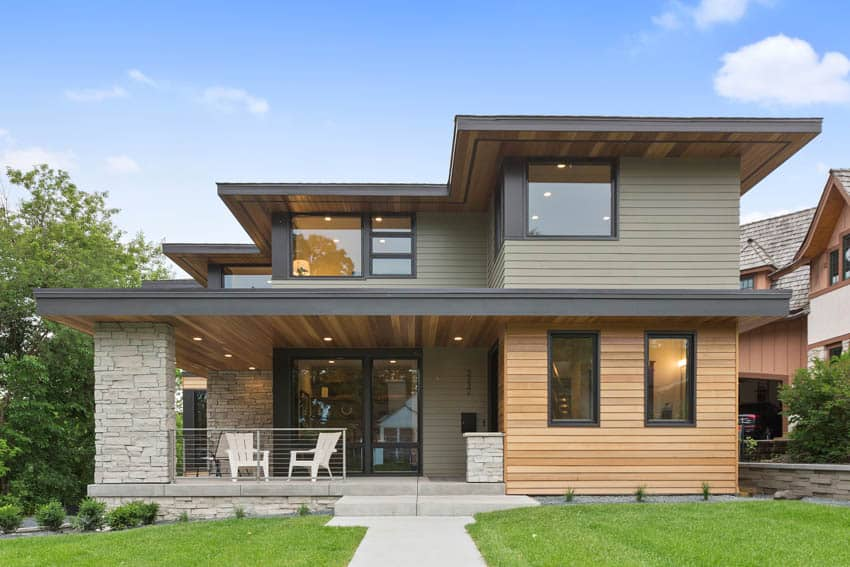 Modern house with wood siding glass doors and windows