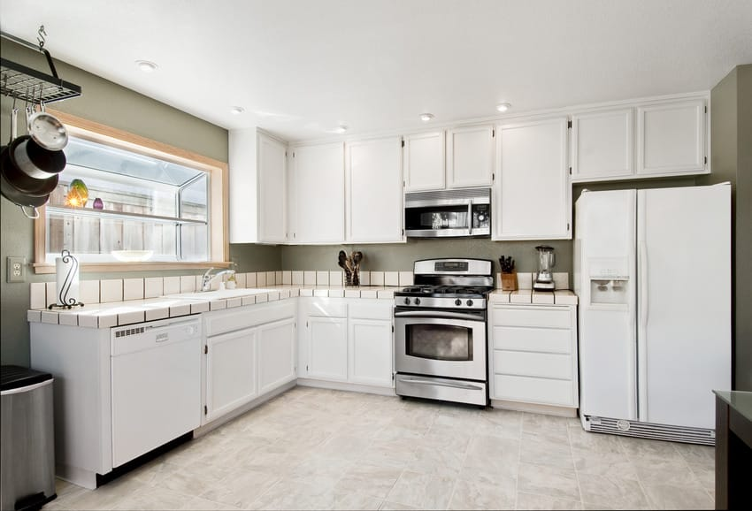 Modern kitchen interior with gray walls tile countertop and flooring