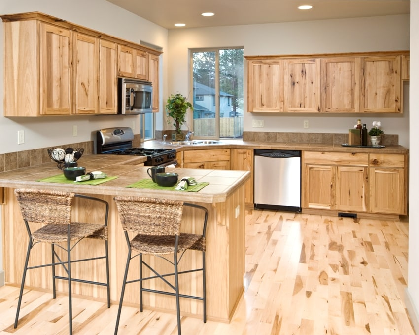 Modern kitchen with hardwood cabinets and floor