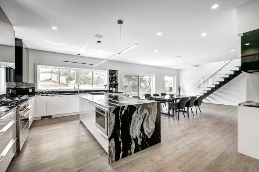 Modern kitchen with marble center island wood floor