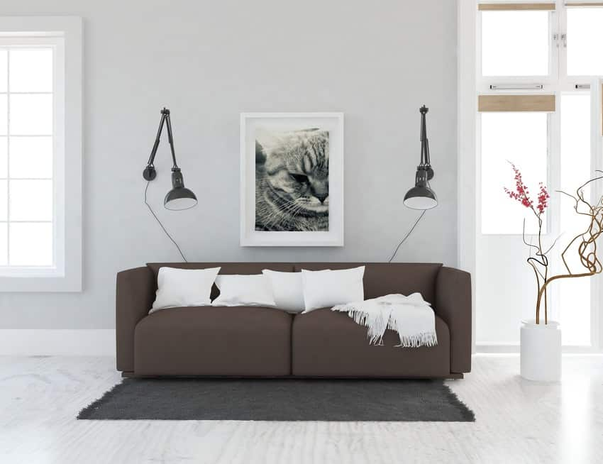 Modern living room interior with light fixtures framed poster and decorative plant