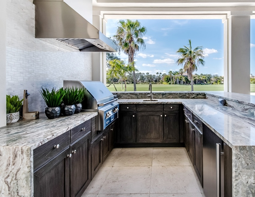 Modern outdoor kitchen with appliances and a beautiful view