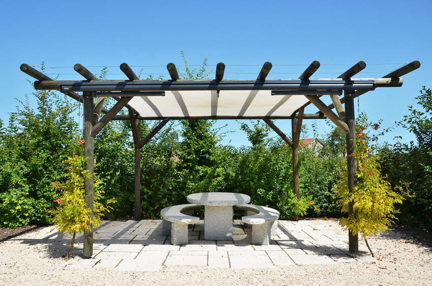 Modern pergola with stylish stone chair