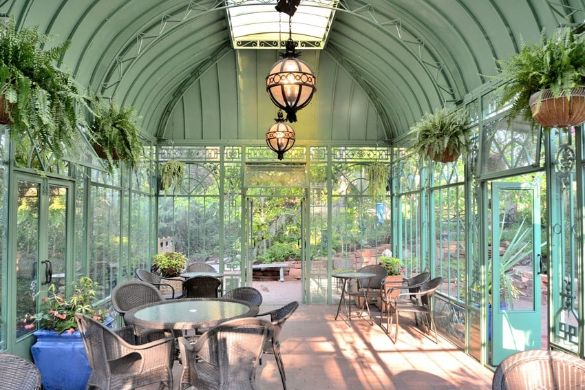 Modern stylish sunroom with furniture plants and light fixtures