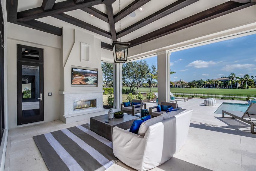 Modern vinyl covered patio with sofa pillows and rug