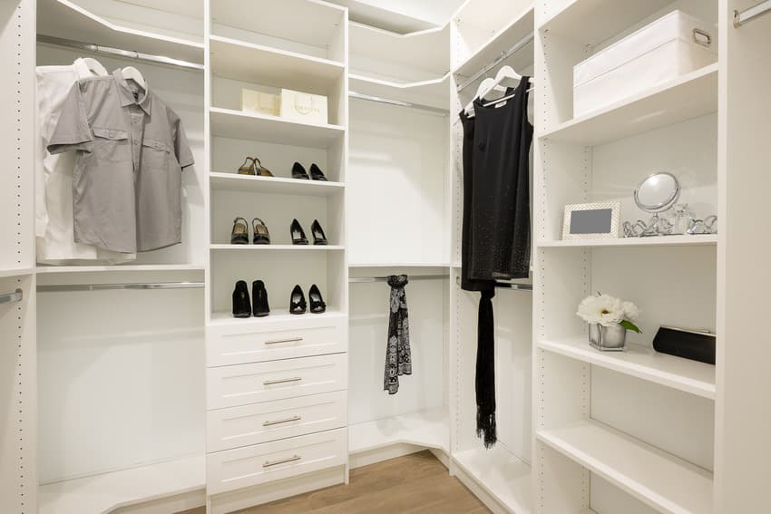 Modern white closet with clothes and shoes