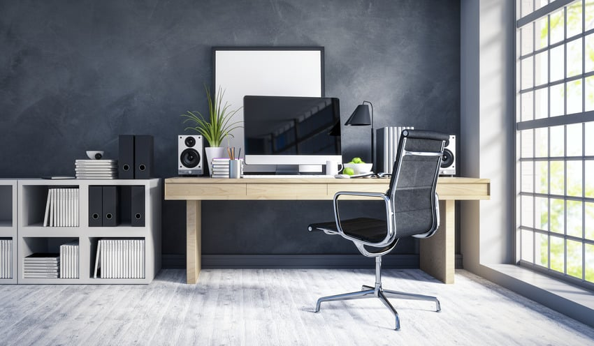 Modern workplace interior with wooden computer desk bookcase and office chair