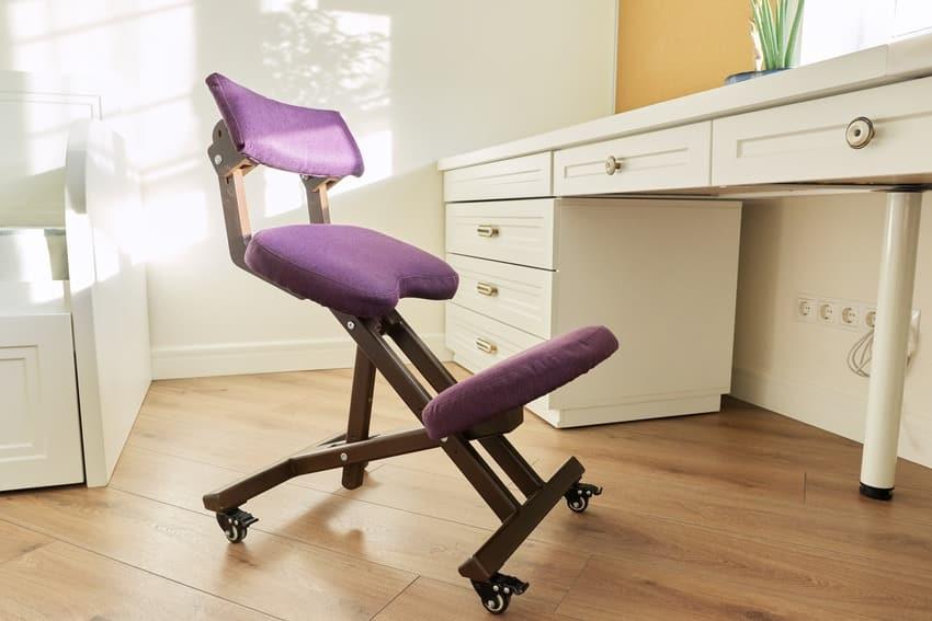 Orthopedic ergonomic kneeling chair in a childs room