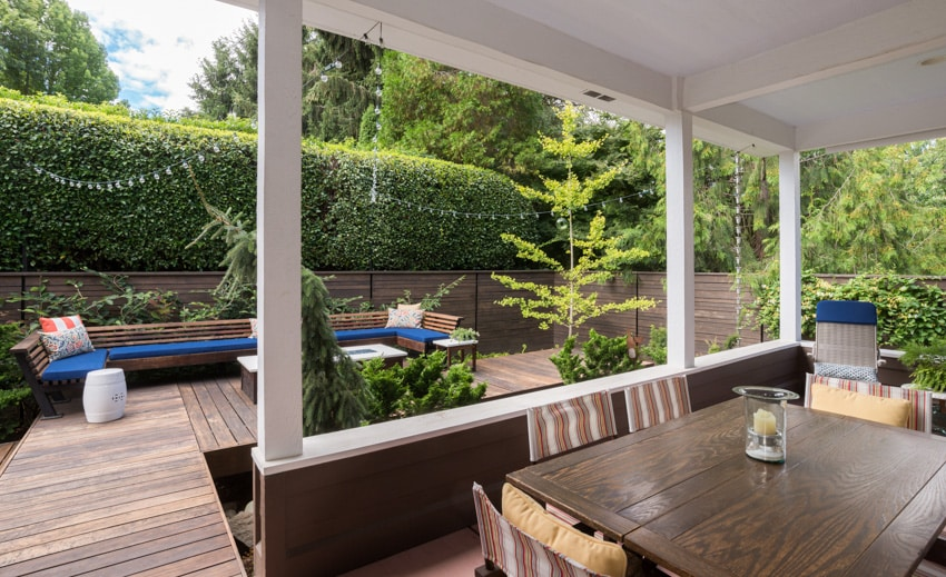 Outdoor deck with wood table and sofa