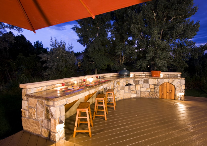 Outdoor dining area with counter lighting