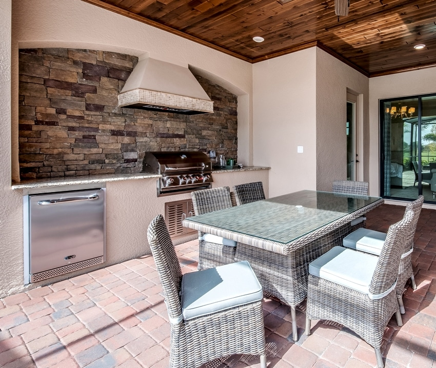 Outdoor kitchen with dishwasher and dining area
