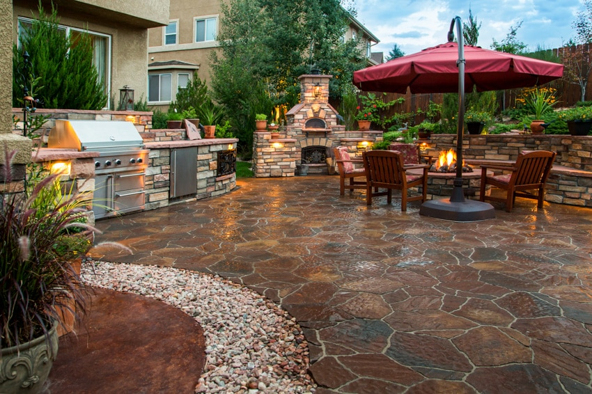 Outdoor kitchen with firepit dining area and epoxy floor