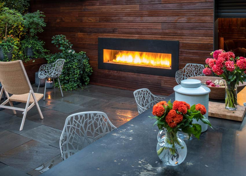 Outdoor patio with custom fireplace slate tiles outdoor furniture