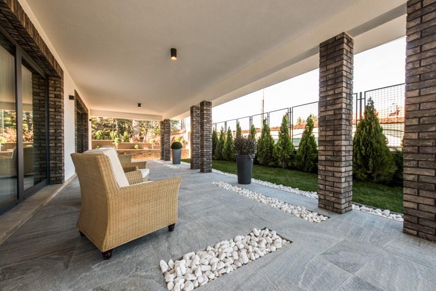 Outdoor sofa chair on concrete patio tiles