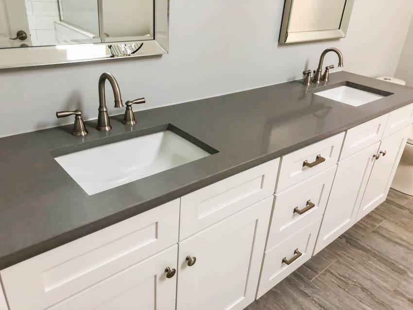 Pair of sinks set inside a concrete countertop bathroom