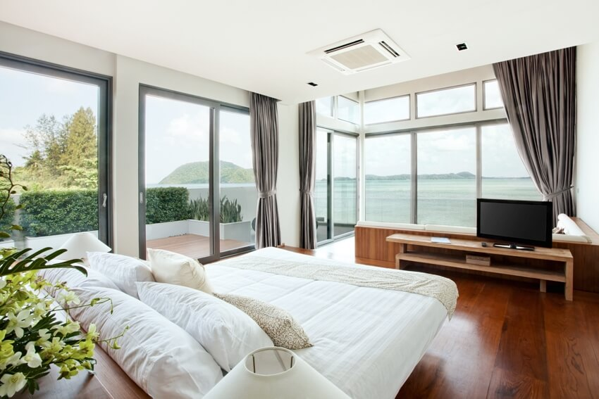 Panoramic view of nice cozy bedroom with summer outdoor