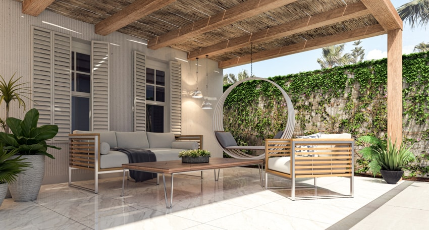Patio with porcelain tiles and sofa chairs and table