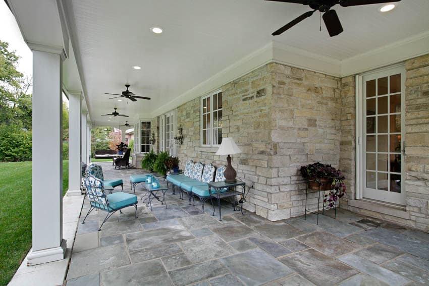 Patio with slate slabs and outdoor furniture