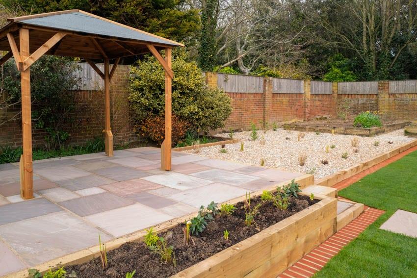 Pergola on slate patio raised flower bed