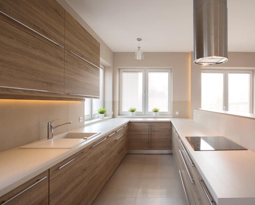 Plywood cupboards in beige kitchen interior