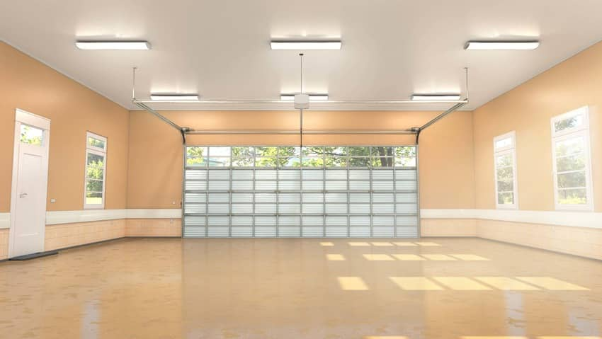 Polished concrete floor installed in a pastel garage interior