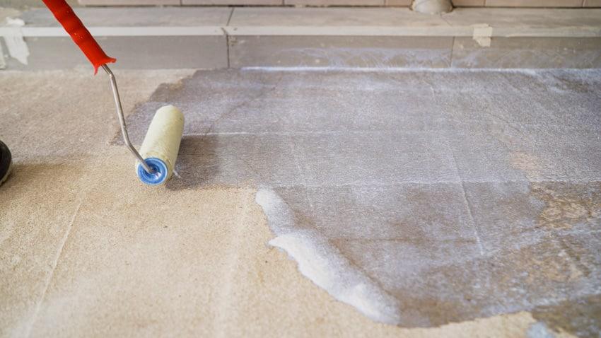 Priming concrete tile floors for epoxy coating