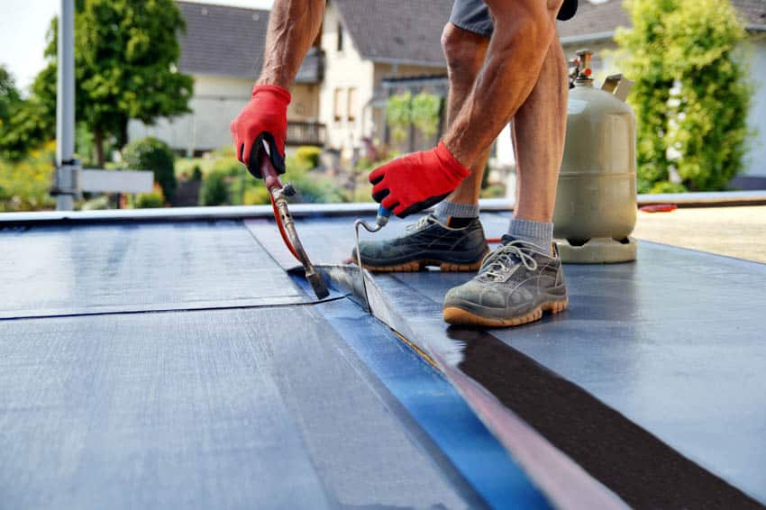 Professional removing peel and stick roofing
