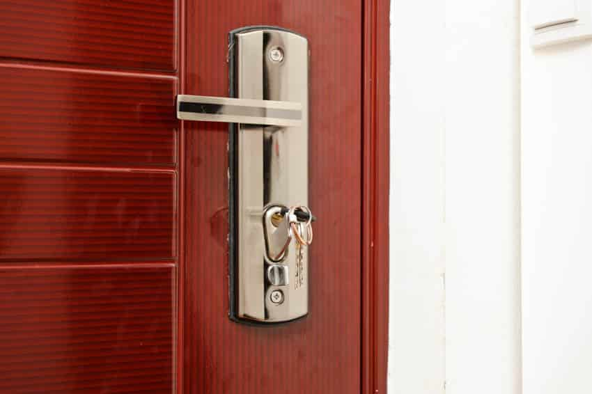 Red door with silver handle and lock