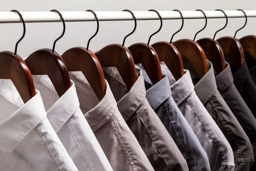 Row of shirts hanging in a closet