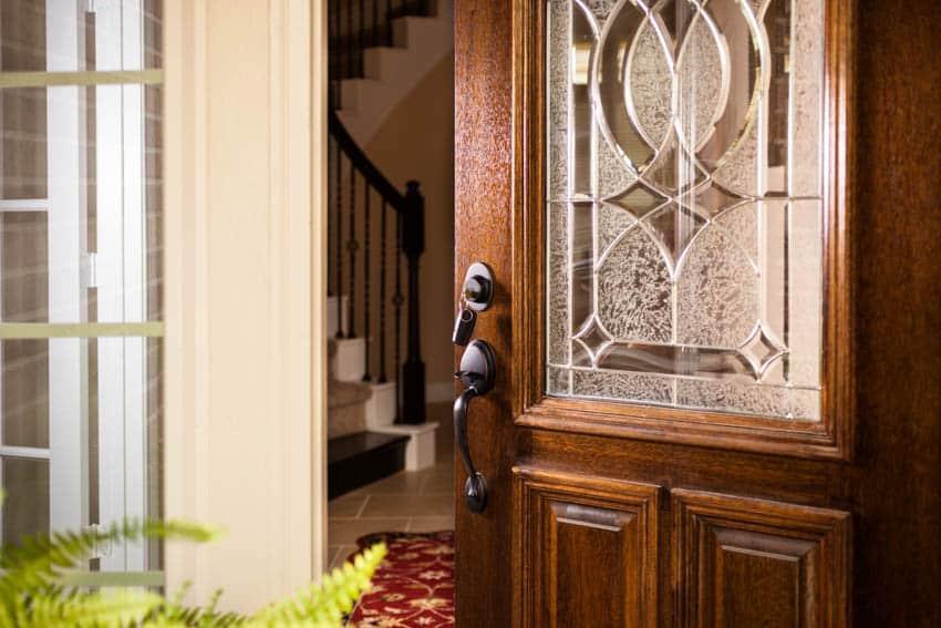 Rustic glass door with handleset and sidelight