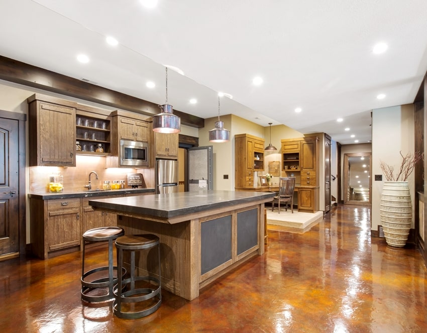 second kitchen with glossy epoxy basement flooring and large kitchen