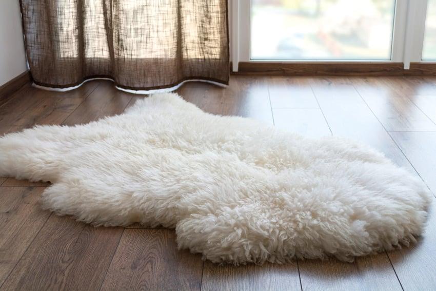 Sheep rug on wooden flooring