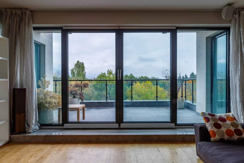 Sliding tinted glass doors curtains wood floor
