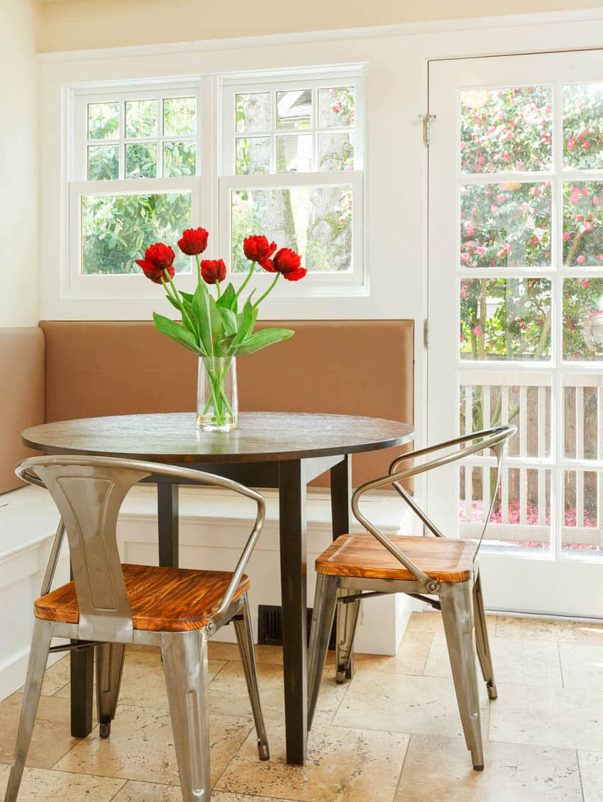 Small kitchen booth glass windows doors round table chairs