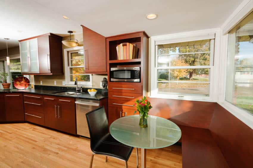Small kitchen with round table and booth