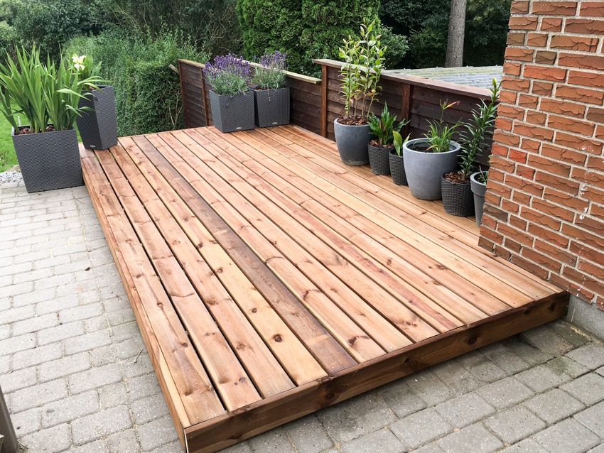 Small wooden deck on concrete