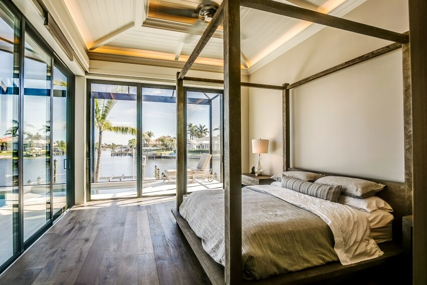 Spacious bedroom with glass walls and a beautiful beach view