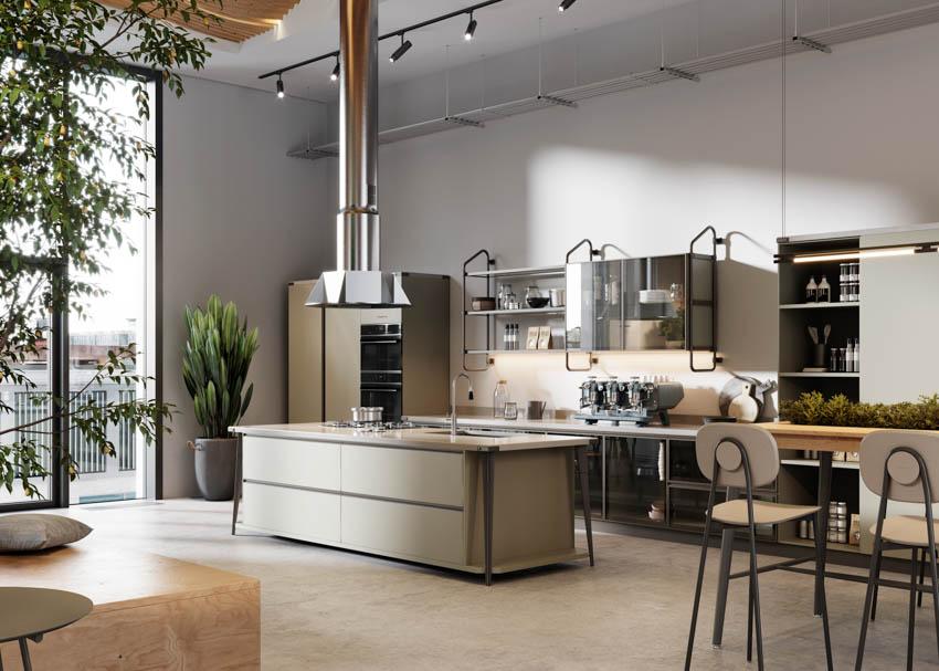 Spacious kitchen with unique center island hood indoor plants